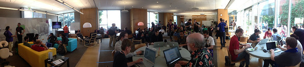 A wide angle of activity ala the Hacker Lounge. Click for full size image.